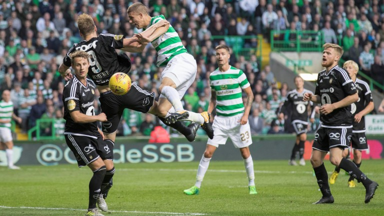 Rosenborg striker Nicklas Bendtner (9) is challenged by Celtic's Jozo Simunovic in a Champions League qualifier last month