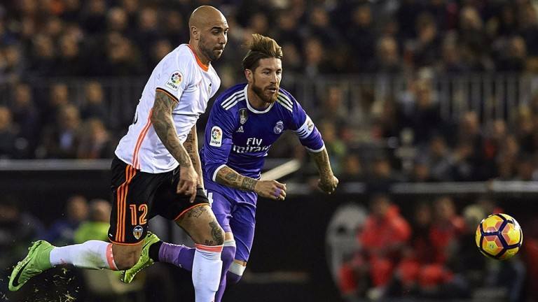 Valencia's Simone Zaza (left) competes with Real Madrid's Sergio Ramos