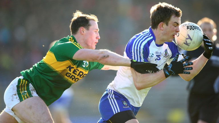 Mark Griffin, seen here getting to grips with Monaghan's Jack McCarron, has been impressive in defence for Kerry this year