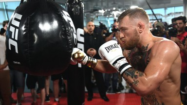 UFC lightweight champion Conor McGregor hits a bag