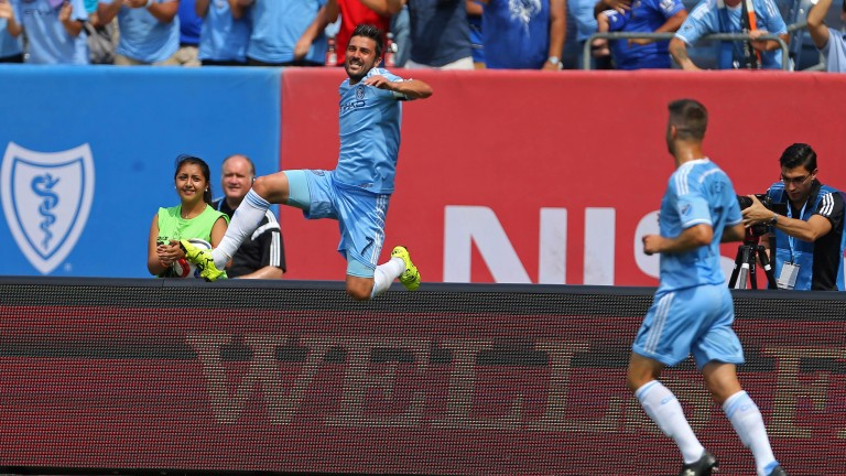 David Villa celebrates after yet another goal