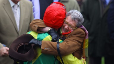 Owner Ann Potts greets jockey Andrew Lynch with a massive hug after winning the Queen Mother Champion Chase with Sizing Europe Cheltenham Festival Photo: Patrick McCann 16.03.2011