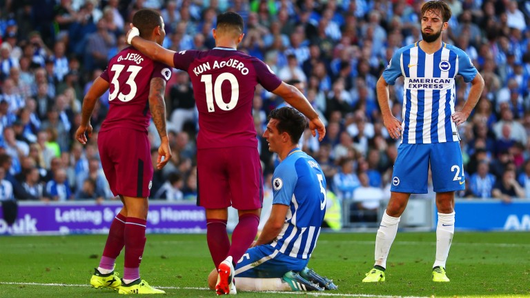 Gabriel Jesus and Sergio Aguero celebrate after an own goal from Brighton's Lewis Dunk