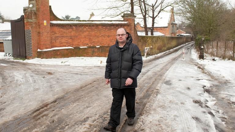 Paul Eacott walks up Chalk Lane pass the Durdans stables