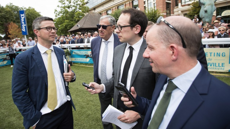 Successful raid: Roger Varian speaks to the press after Ajman Princess's victory in the Prix Jean Romanet