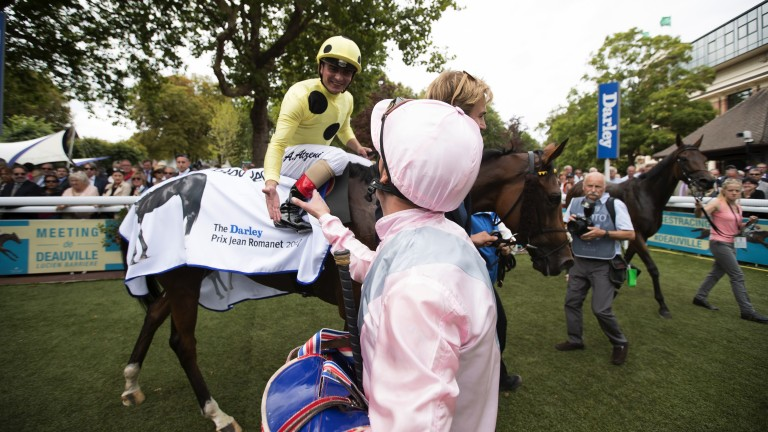 Well done: Frankie Dettori congratulates Andrea Atzeni after his success in the Prix Jean Romanet on Ajman Princess
