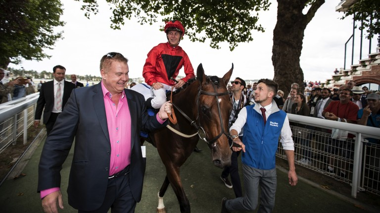 All smiles: delighted owner John Laughton leads in Unfortunately after his colt landed the Prix Morny