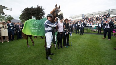 Jim Crowley poses with Ulysses after completing their greatest success