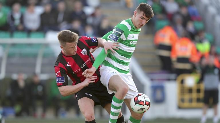 Longford Town's Daniel O'Reilly (left) tackles Shamrock Rovers' Sean Boyd