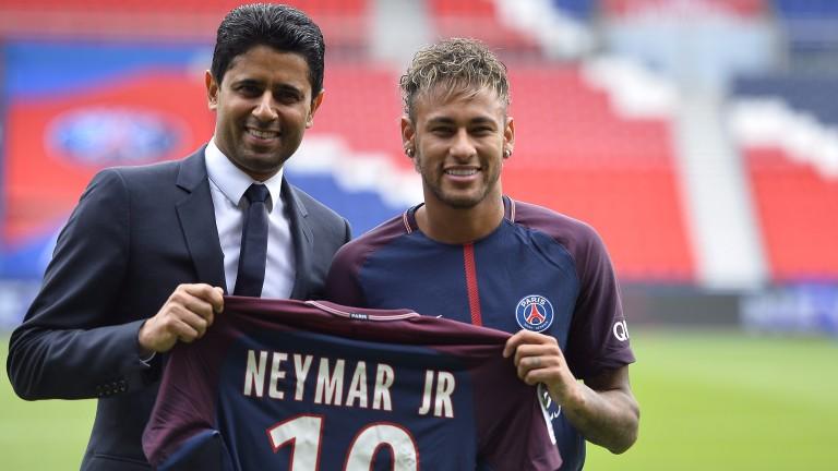 Neymar poses with his new jersey next to Paris Saint-Germain President Nasser Al-Khelaifi