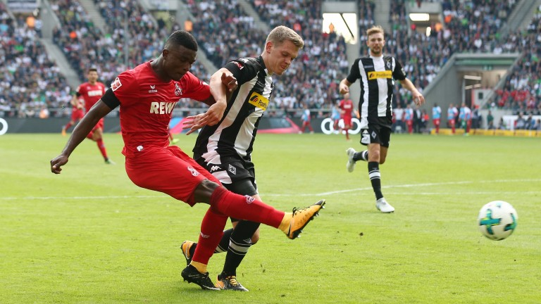Jhon Cordoba shoots for Cologne in their loss at Moenchengladbach