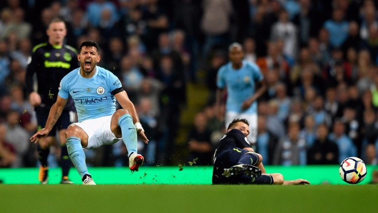 Sergio Aguero receives some rough treatment in the draw with Everton