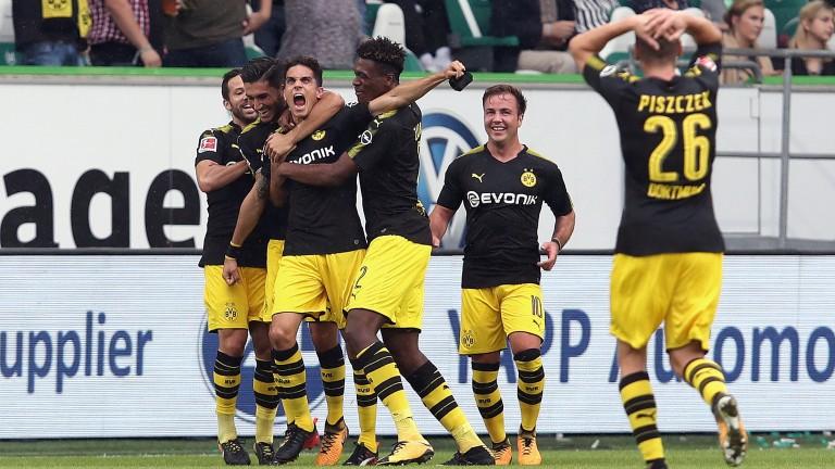 Borussia Dortmund celebrate a goal against Wolfsburg