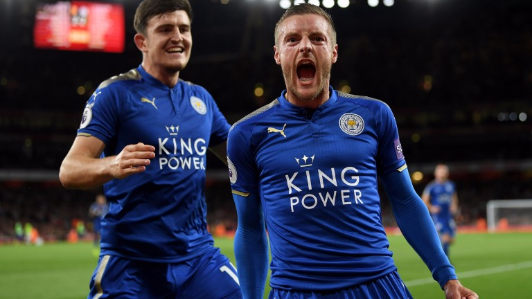Jamie Vardy celebrates scoring for Leicester at Arsenal