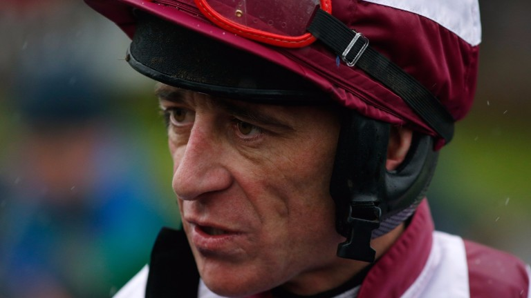 Davy Russell: punched Kings Dolly on the head before start of a mares' handicap hurdle