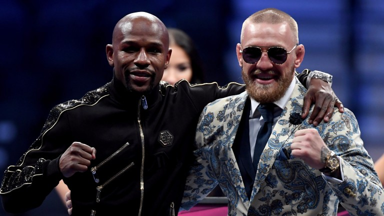 Floyd Mayweather (left) and Conor McGregor make friends after the fight