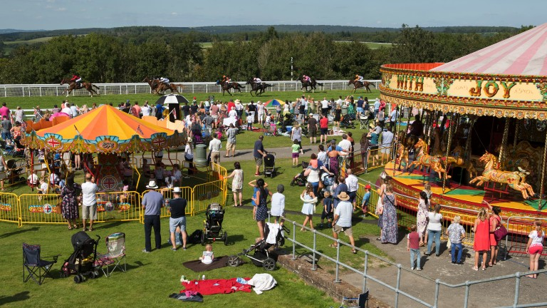 Eyes on the action: a large family crowd watch Delannoy win the 1m3f seller