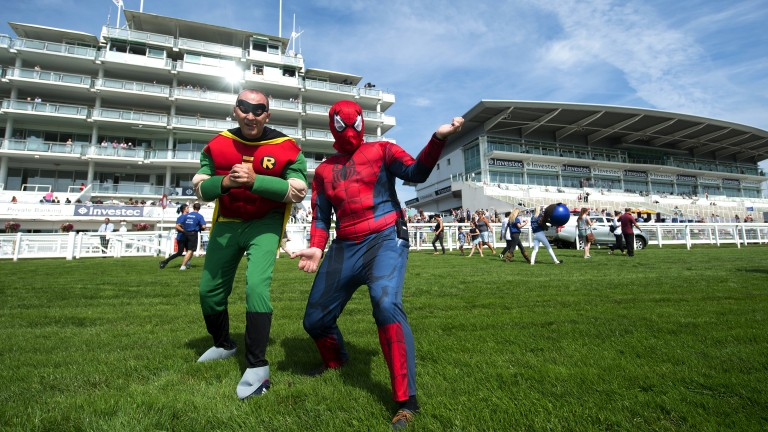 Superheroes: racegoers dress up for the bank holiday meeting at Epsom