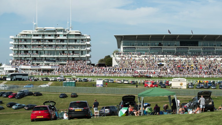 Clear view: families enjoy the races from the centre of the course