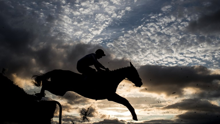A dramatic sky as the action unfolds in a 2m6f beginners' chase