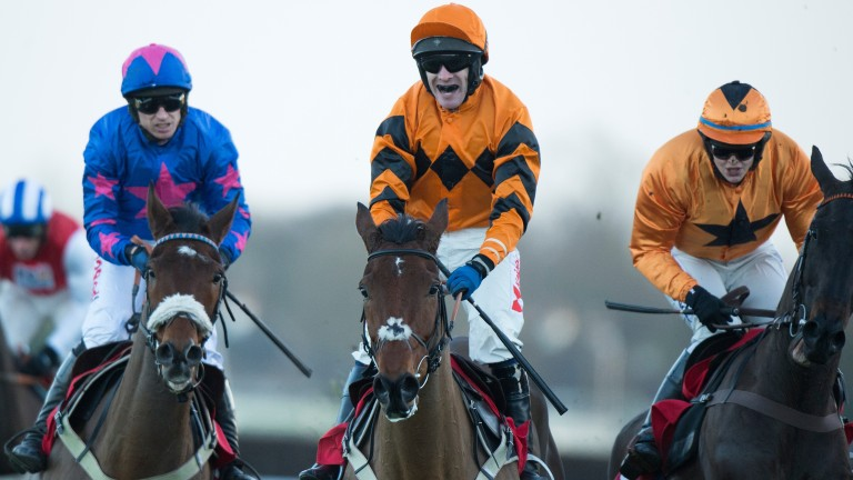 Thistlecrack (Tom Scudamore, centre) and Cue Card (Paddy Brennan, left) pull up after finishing first and second in the King George