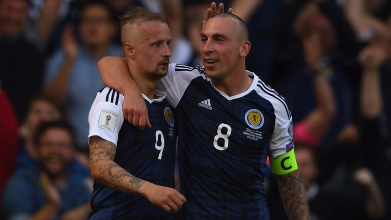 Scotland's Leigh Griffiths (left) and Scott Brown celebrate against England