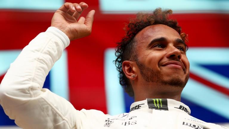 Lewis Hamilton celebrates after his Belgian Grand Prix victory