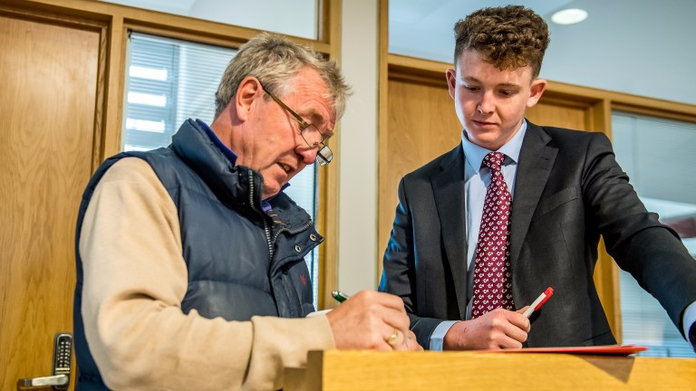 Bryan Smart signs a docket at last year's Goffs UK Silver Yearling Sale