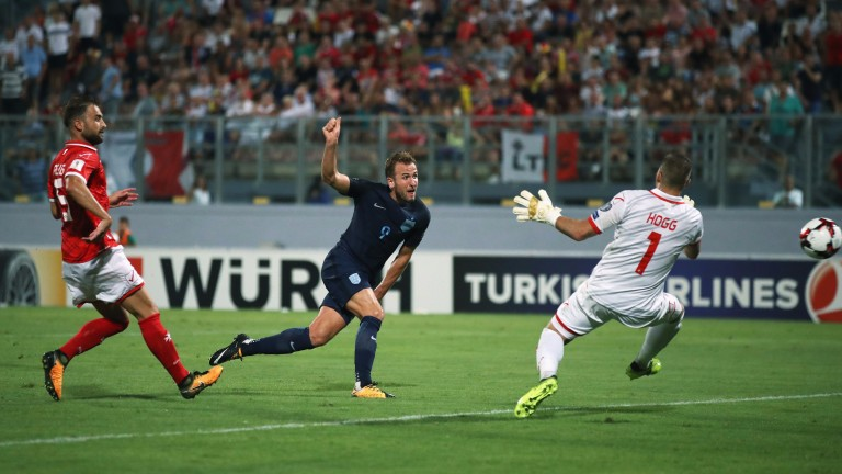 England's Harry Kane scores past Andrew Hogg of Malta
