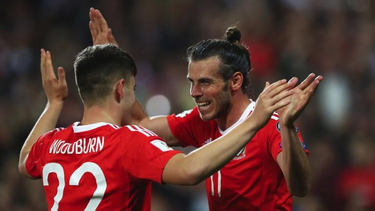 Ben Woodburn celebrates scoring against Austria with Gareth Bale