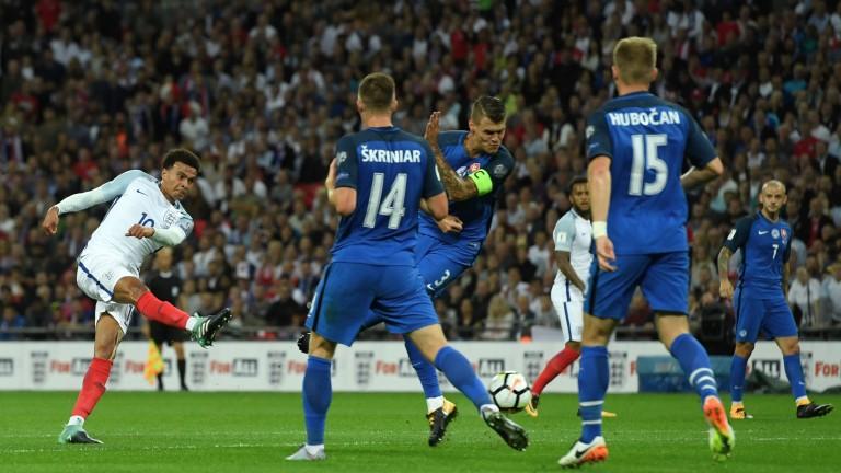 Dele Alli takes a shot against Slovakia