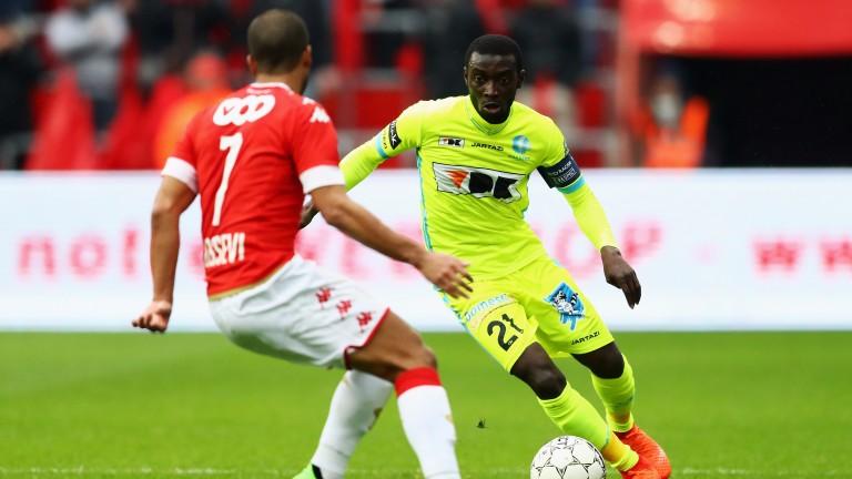 Standard's Mathieu Dossevi (left) challenges Nana Asare of Gent