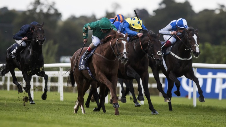 Decorated Knight and Andrea Atzeni (green) power on to victory in the Irish Champion Stakes