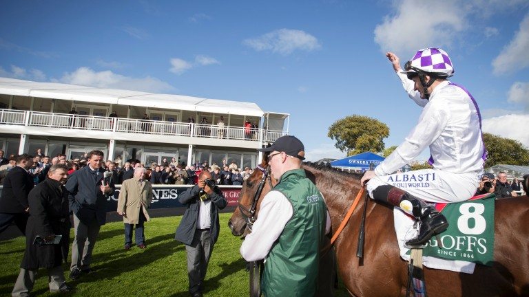 Kevin Manning returns in front of the temporary Curragh facilities after Verbal Dexterity's win in the National Stakes