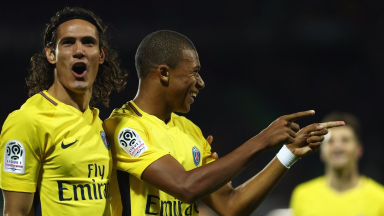 Edinson Cavani and Kylian Mbappe enjoy a Paris Saint-Germain goal