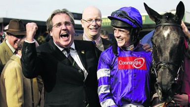 Ruby Walsh looks bemused by the owner's antics while Royal & SunAlliance Chase winner Denman takes it in his stride