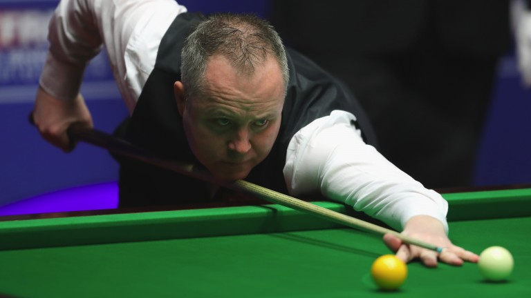 John Higgins may need to be on the ball against Zhao Xintong