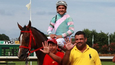 Jorge Navarro (right) celebrates five wins in one day at Monmouth Park in July 2017