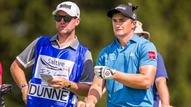Paul Dunne chats to his caddie at the Paul Lawrie Matchplay last month