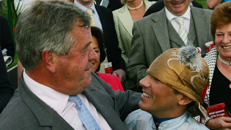 Sir Michael Stoute and Frankie Dettori celebrate Conduit's success in the 2008 St Leger