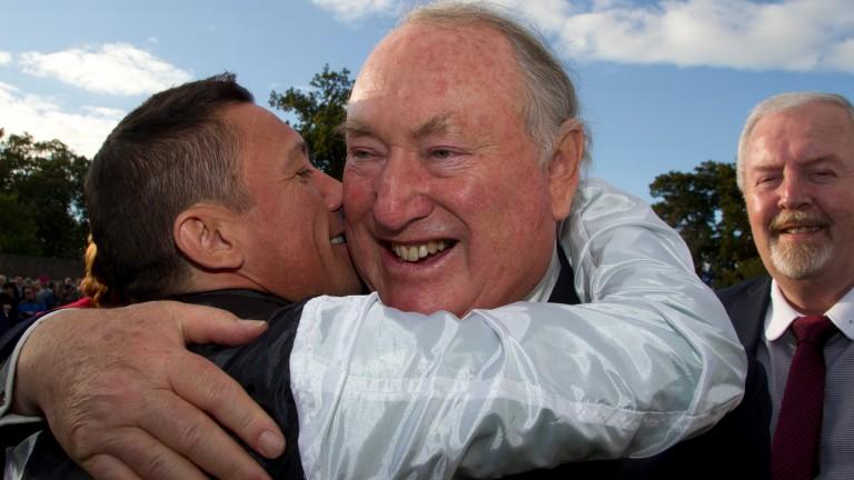 Frankie Dettori hugs Anthony Oppenheimer after winning the 2015 Irish Champion Stakes on Golden Horn