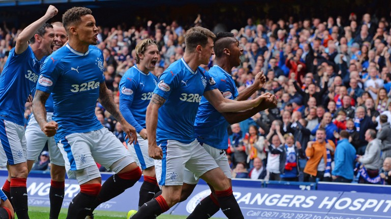 Alfredo Morelos (right) celebrates with Rangers teammates