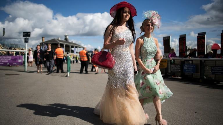 Elegantly dressed: two ladies make their way through the main enclosure