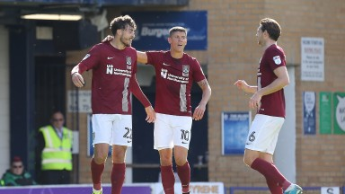 SOUTHEND, ENGLAND - SEPTEMBER 16:Matt Crooks of Northampton Town is congratulated by team mates Alex Revell and Ash Taylor after scoring his sides second goal during the Sky Bet League One match between Southend United and Northampton Town at Roots Hall o