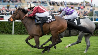 Heartache (maroon) pricks her ears passing the winning post as she lands the Flying Childers Stakes