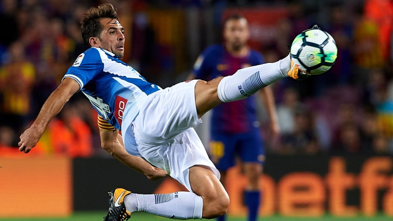 Victor Sanchez of Espanyol in action against Barcelona