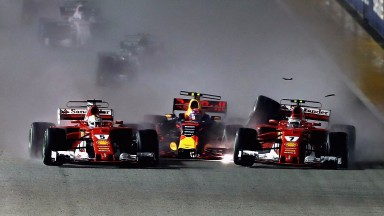 Carnage at the start as Sebastian Vettel (right) squeezes Max Verstappen into Kimi Raikkonen