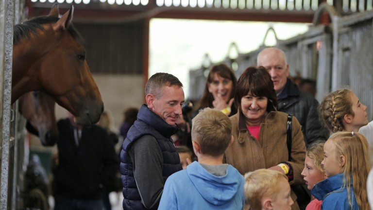 Man in demand: Paul Hanagan meets some young fans at Richard Fahey's base
