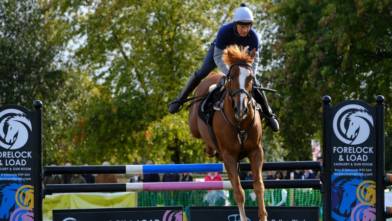 Flying high: Newmarket trainer Roger Varian takes to the saddle in the showjumping
