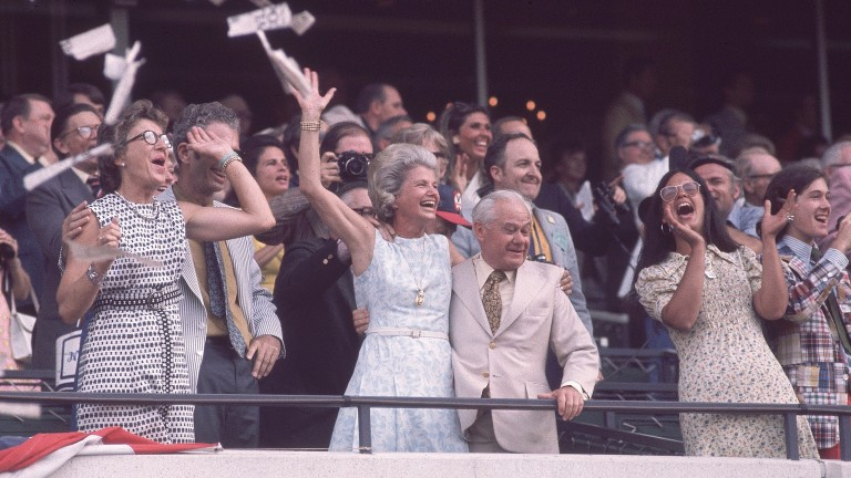 Penny Chenery (then Tweedy) celebrates with trainer Lucien Laurin as Secretariat completes the Triple Crown in the 1973 Belmont Stakes